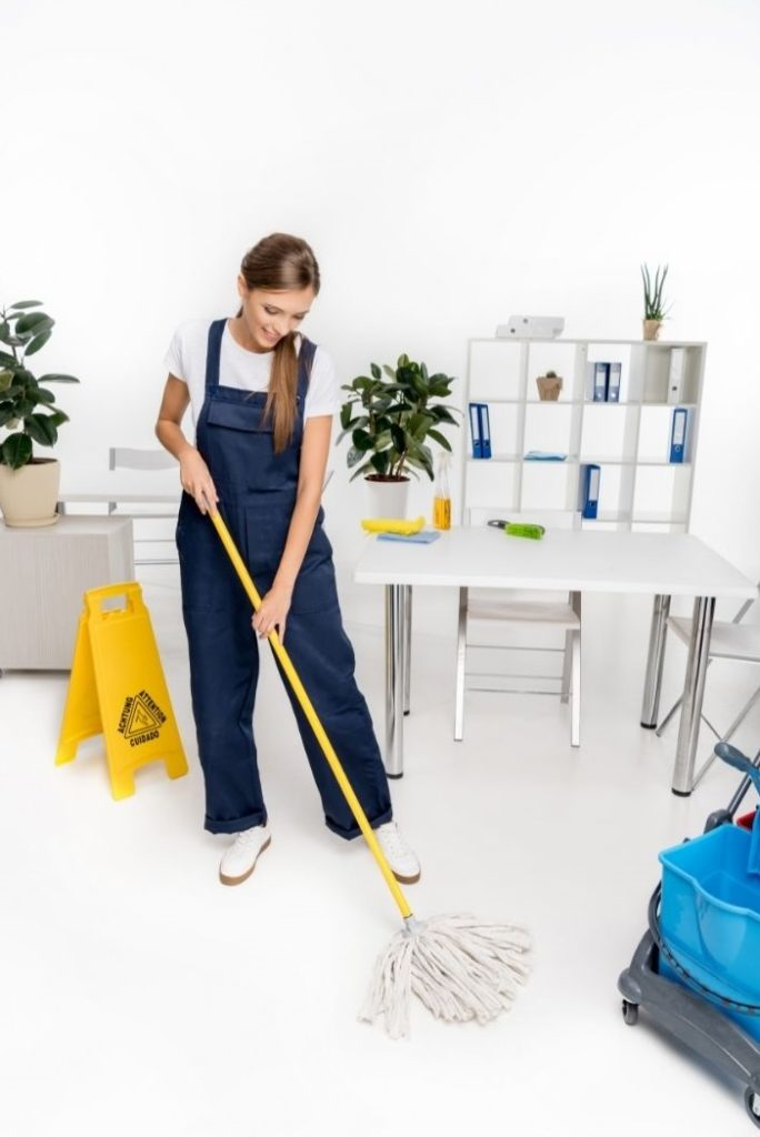 Maid deep cleaning with a mop
