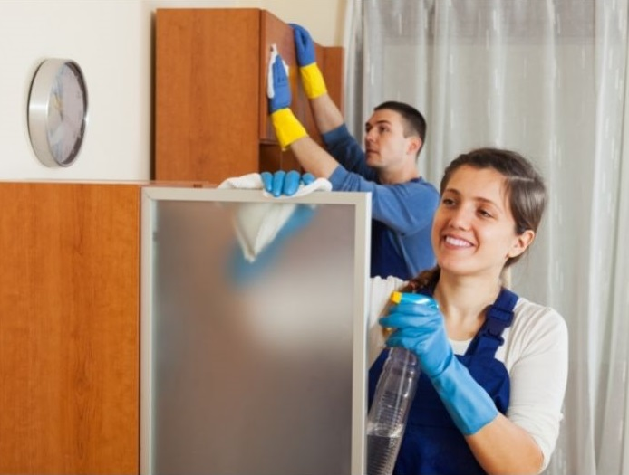 Men and Women Maid performing Cleaning at home