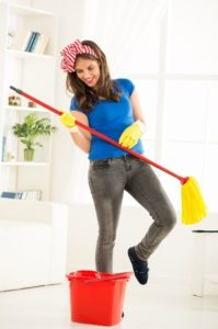 Happy Female Maid Holding a Mop