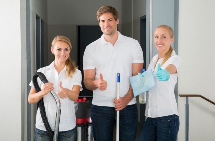 Smiling Maid Employees showing thumb
