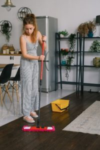 Maid Performing Floor Cleaning
