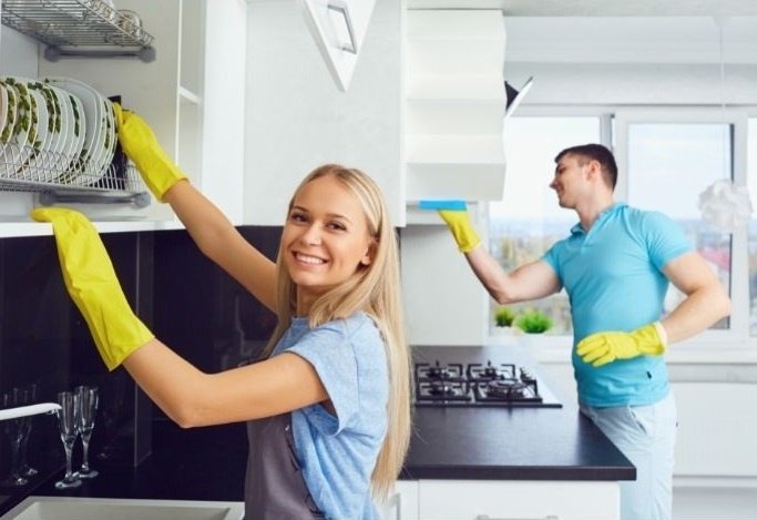 Professional Maids Are cleaning Kitchen at home