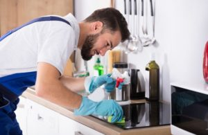 Male Maid Cleaning Kitchen