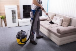 Professional Maid Cleaning Sofa with a Machine