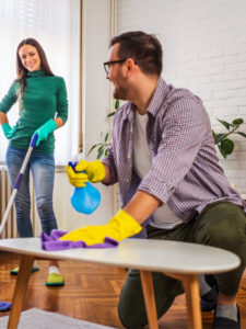couple cleaning an apartment